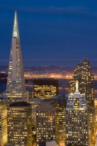 High angle view of the illuminated buildings and the Transamerica Pyramid of the CBD in San Francisco at night. Travel Photography from PhotoEverywhere
